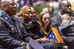 Joann Williams holds the U.S. flag that flew over the Capitol to honor her husband, during the memorial service for slain Lowndes County Sheriff