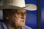 FILE — In this Aug. 4, 2009, file photo, former Houston Oilers head coach Bum Phillips watches the Dallas Cowboys NFL football training camp in San Antonio. The Tennessee Titans announced July 14, 2021, that Phillips, former Tennessee Titans head coach Jeff Fisher, and former Titans general manager Floyd Reese will be the newest members of the Tennessee Titans' ring of honor. (AP Photo/Eric Gay)