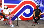 Mercedes driver Lewis Hamilton of Britain and Mercedes driver Valtteri Bottas of Finland attend the press conference in the build-up to the 70th Anniversary Formula One Grand Prix at the Silverstone circuit, Silverstone, England, Thursday, Aug. 6, 2020.(Mark Sutton/Pool via AP)