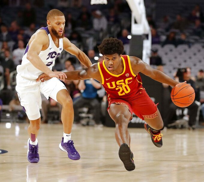 Southern California guard Ethan Anderson (20) is defended by TCU guard Edric Dennis Jr. (2) during the second half of an NCAA college basketball game in Fort Worth, Texas, Friday, Dec. 6, 2019. (Bob Booth/Star-Telegram via AP)