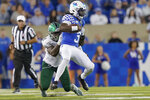 Kentucky quarterback Terry Wilson (3) is tackled by Eastern Michigan defensive lineman Turan Rush (99) during the second half of an NCAA college football game between Kentucky and Eastern Michigan, Saturday, Sept. 7, 2019, in Lexington, Ky. Wilson was injured and left the game on a cart as a result of the play. (AP Photo/Bryan Woolston)