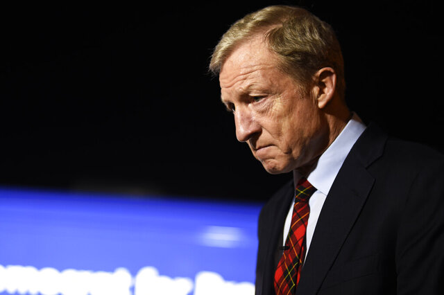 Democratic presidential hopeful Tom Steyer takes questions from reporters before a campaign event in Florence, S.C., Saturday, Jan. 18, 2020. (AP Photo/Meg Kinnard)