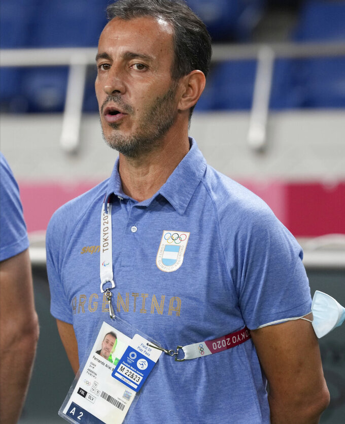 Argentina's coach Fernando Batista sings the national anthem prior a men's soccer match against Spain at the 2020 Summer Olympics, Wednesday, July 28, 2021, in Saitama, Japan. (AP Photo/Martin Mejia)