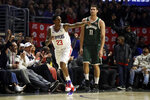 Los Angeles Clippers' Lou Williams (23) points after making 3-point basket, in front of Milwaukee Bucks' Brook Lopez (11) during the second half of an NBA basketball game Wednesday, Nov. 6, 2019, in Los Angeles. (AP Photo/Marcio Jose Sanchez)
