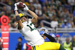 Green Bay Packers wide receiver Allen Lazard (13), defended by Detroit Lions cornerback Darius Slay, catches a 28-yard pass for a touchdown during the second half of an NFL football game, Sunday, Dec. 29, 2019, in Detroit. (AP Photo/Rick Osentoski)
