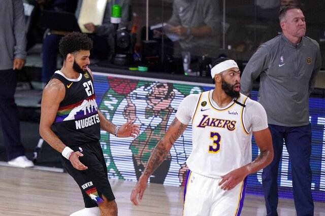 Denver Nuggets' Jamal Murray (27) celebrates sinking a 3-point basket as Los Angeles Lakers' Anthony Davis (3) and head coach Michael Malone, right rear, look on during the second half of Game 3 of the NBA basketball Western Conference final Tuesday, Sept. 22, 2020, in Lake Buena Vista, Fla. (AP Photo/Mark J. Terrill)