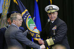 Deputy Secretary of Defense David Norquist, left, hands the US Strategic Command flag to Vice Adm. Charles A. Richard, during a change of command ceremony at Offutt AFB in Nebraska, Monday, Nov. 18, 2019. A dedication ceremony was also held for C2F, US Strategic Command's new command and control facility. (AP Photo/Nati Harnik)