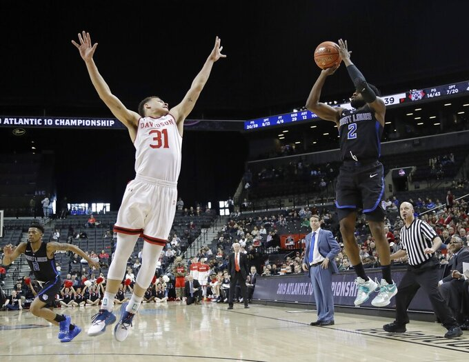 Saint Louis' Tramaine Isabell Jr. (2) shoots over Davidson's Kellan Grady (31) during the second half of an NCAA college basketball game in the semifinal round of the Atlantic 10 men's tournament Saturday, March 16, 2019, in New York. Saint Louis won 67-44. (AP Photo/Frank Franklin II)