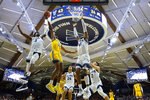 La Salle's Isiah Deas (10) goes up to shoot between Villanova's Brandon Slater (3) and Saddiq Bey (41) during the first half of an NCAA college basketball game, Sunday, Dec. 1, 2019, in Villanova, Pa. (AP Photo/Matt Slocum)