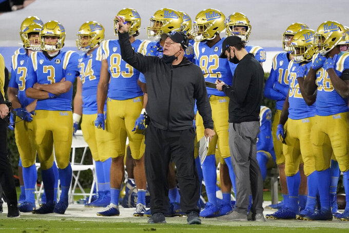 UCLA coach Chip Kelly signals from the sideline during the second half of the team's NCAA college football game against Arizona on Saturday, Nov. 28, 2020, in Pasadena, Calif. (AP Photo/Marcio Jose Sanchez)