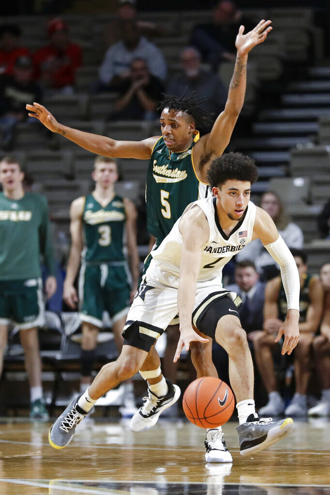 Vanderbilt guard Scotty Pippen Jr. (2) drives past Southeastern Louisiana guard Byron Smith (5) in the second half of an NCAA college basketball game Monday, Nov. 25, 2019, in Nashville, Tenn. Vanderbilt won 78-70. (AP Photo/Mark Humphrey)