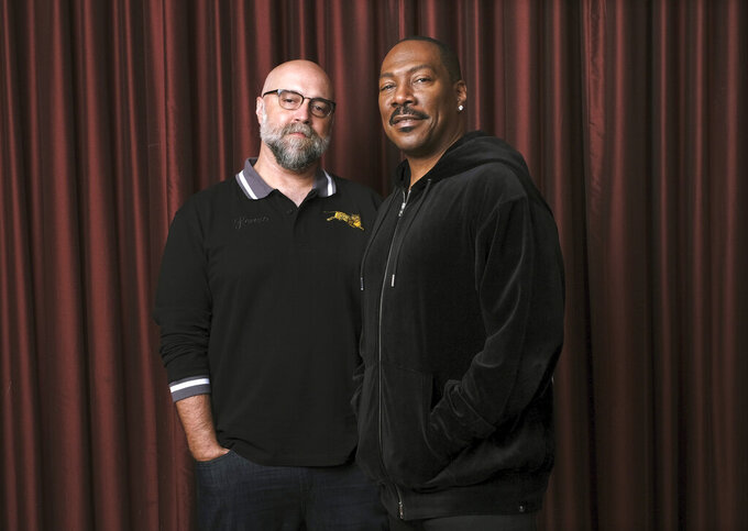"""FILE - Actor Eddie Murphy, right, poses with director Craig Brewer during the Toronto International Film Festival in Toronto on Sept. 7, 2019.  Murphy stars in """"Coming 2 America,"""" available on Amazon Prime on March 5. (Photo by Chris Pizzello/Invision/AP, File)"""