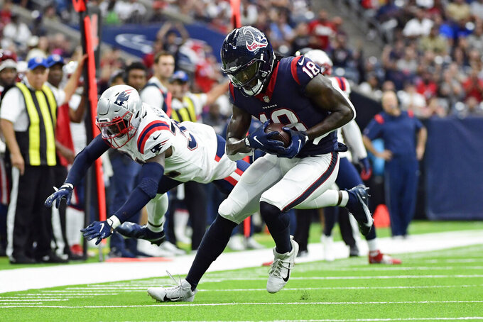 Houston Texans wide receiver Chris Conley (18) breaks away from New England Patriots safety Devin McCourty after catching a pass during the first half of an NFL football game Sunday, Oct. 10, 2021, in Houston. (AP Photo/Justin Rex)