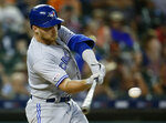 Toronto Blue Jays' Brandon Drury hits a two-run home run against the Detroit Tigers during the sixth inning of a baseball game, Saturday, July 20, 2019, in Detroit. (AP Photo/Duane Burleson)