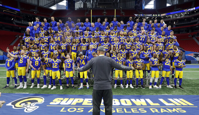 The Los Angeles Rams poses for a team photo during walkthrough for the NFL Super Bowl 53 football game against the New England Patriots, Saturday, Feb. 2, 2019, in Atlanta. (AP Photo/John Bazemore)