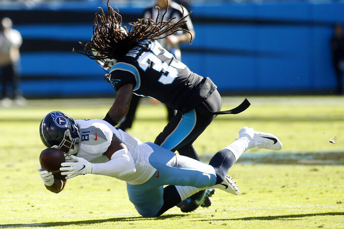 Tennessee Titans tight end Jonnu Smith (81) catches a pass while Carolina Panthers defensive back Tre Boston (33) defends during the first half of an NFL football game in Charlotte, N.C., Sunday, Nov. 3, 2019. (AP Photo/Brian Blanco)
