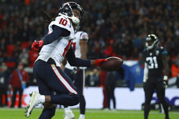 Houston Texans wide receiver DeAndre Hopkins (10) celebrates his touchdown against the Jacksonville Jaguars during the second half of an NFL football game at Wembley Stadium, Sunday, Nov. 3, 2019, in London. (AP Photo/Ian Walton)