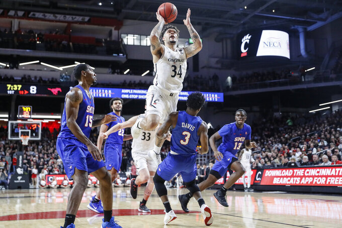 Cincinnati's Jarron Cumberland (34) shoots over SMU's Kendric Davis (3) during the first half of an NCAA college basketball game Tuesday, Jan. 28, 2020, in Cincinnati. (AP Photo/John Minchillo)