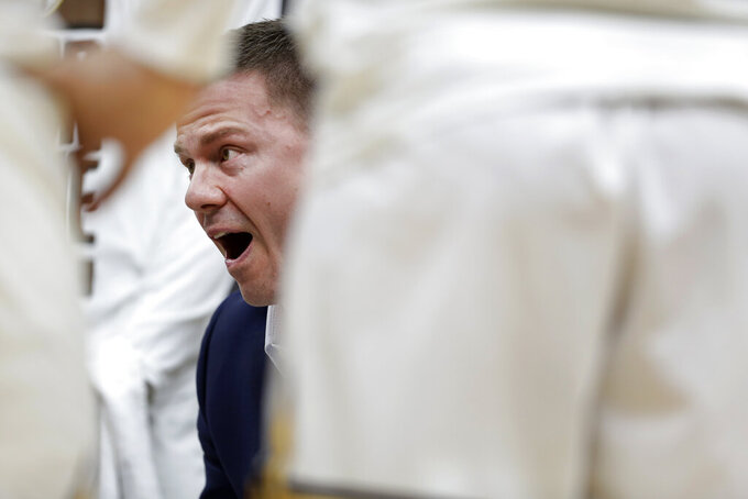 Valparaiso head coach Matt Lottich talks to his team during a timeout in the first half of an NCAA college basketball game against Evansville in the first round of the Missouri Valley Conference men's tournament Thursday, March 5, 2020, in St. Louis. (AP Photo/Jeff Roberson)