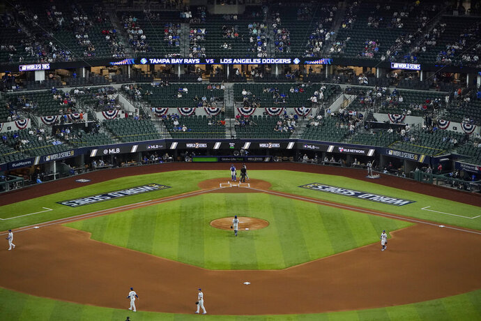 A limited number of spectators watch the Los Angeles Dodgers play against the Tampa Bay Rays during the first inning in Game 2 of the baseball World Series Wednesday, Oct. 21, 2020, in Arlington, Texas. (AP Photo/Sue Ogrocki)
