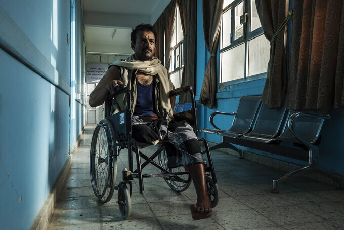 Yemeni fighter 42-year-old Sam Saleh Abdullah, who was severely injured and had his right leg amputated from clashes with Houthi rebels, stops for a photograph, at the Marib Hospital in Yemen, Monday, June 21, 2021. On the most active front line in Yemen's long civil war, the months-long battle for the city of Marib has become a dragged-out grind with a steady stream of dead and wounded from both sides. (AP Photo/Nariman El-Mofty)
