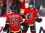 Calgary Flames' Michael Frolik, right, of the Czech Republic, celebrates his goal with teammate Oliver Kylington, of Sweden, during second-period NHL hockey game action against the Florida Panthers in Calgary, Alberta, Friday, Jan. 11, 2019. (Jeff McIntosh/The Canadian Press via AP)