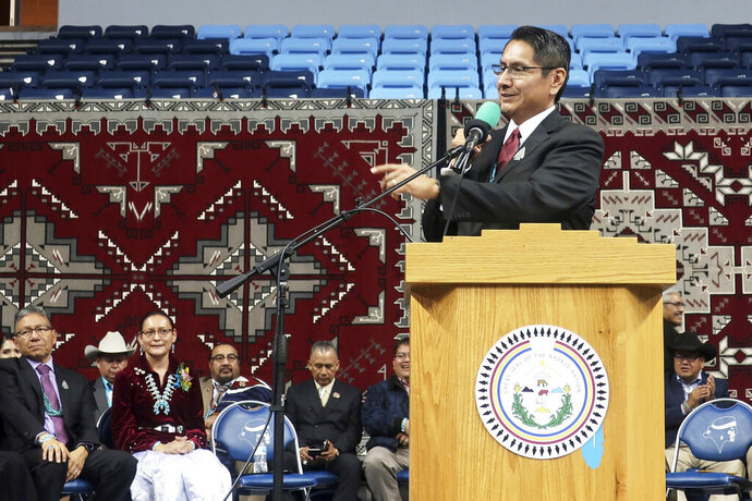 File - In this Jan. 15, 2019, file photo, Jonathan Nez addresses a crowd after he was sworn in as president of the Navajo Nation in Fort Defiance, Arizona. Nez has asked President Donald Trump to commute the death sentence of fellow tribe member Lezmond Mitchell to life in prison. Nez cited the tribe's longstanding opposition to the death penalty in a July 31, 2020, letter to Trump. Mitchell is scheduled to be executed on Aug. 26. (AP Photo/Felicia Fonseca, File)