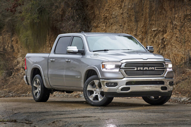 This image provided by Fiat Chrysler Automobiles shows the 2021 Ram 1500 Laramie. Truck and SUV sales are otter than ever. If you need a mode of transportation for a growing family, what would be best for you — a truck, SUV or maybe a minivan? (Fiat Chrysler Automobiles via AP)