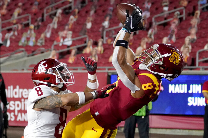 Southern California wide receiver Amon-Ra St. Brown, right, catches a touchdown over Washington State defensive back Armani Marsh during the first half of an NCAA college football game in Los Angeles, Sunday, Dec. 6, 2020. (AP Photo/Alex Gallardo)