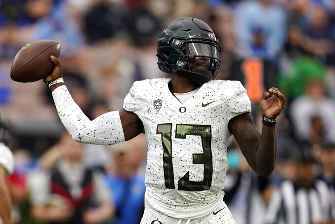 Oregon quarterback Anthony Brown throws during the first half of an NCAA college football game against UCLA, Saturday, Oct. 23, 2021, in Pasadena, Calif. (AP Photo/Marcio Jose Sanchez)