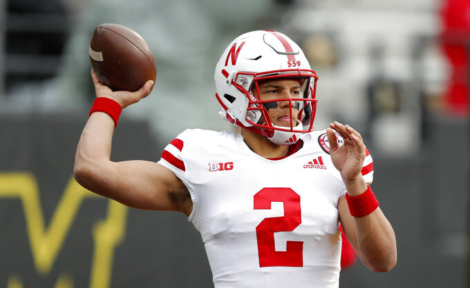 Nebraska quarterback Adrian Martinez warms up before an NCAA college football game against Iowa, Friday, Nov. 23, 2018, in Iowa City, Iowa. (AP Photo/Charlie Neibergall)
