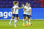 United States midfielder Samantha Mewis, left, celebrates after scoring a goal against Colombia with defender Kelly O'Hara, right, during the first half of an international friendly soccer match, Monday, Jan. 18, 2021, in Orlando, Fla. (AP Photo/John Raoux)