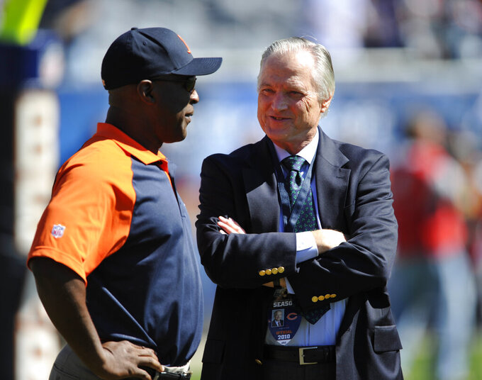 FILE - In this Sunday, Sept. 12, 2010, file photo, then-Chicago Bears head coach Lovie Smith, left, talks with Mike McCaskey, former chairman of the Chicago Bears before an NFL football game against the Detroit Lions in Chicago. Michael McCaskey, who led the Chicago Bears for nearly three decades following the death of his grandfather George Halas, died Saturday, May 16, 2020, after a lengthy battle with cancer, the team said. He was 76. (AP Photo/Jim Prisching, File)