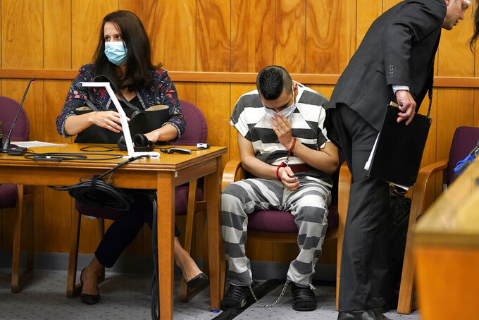 Cristhian Bahena Rivera, center, waits for his sentencing hearing to begin, Monday, Aug. 30, 2021, at the Poweshiek County Courthouse in Montezuma, Iowa. Rivera was sentenced to life in prison for the stabbing death of college student Mollie Tibbetts, who was abducted as she was out for a run near her small eastern Iowa hometown in July of 2018. (AP Photo/Charlie Neibergall, pool)