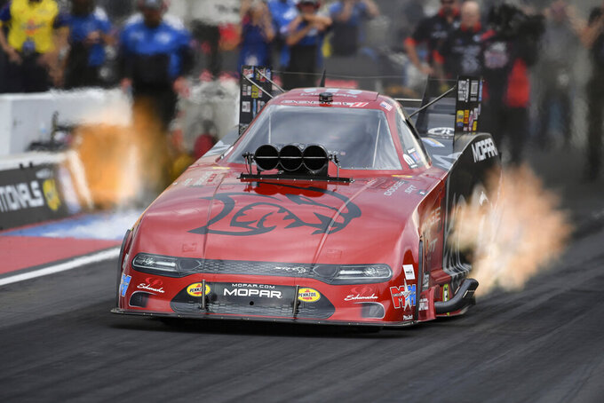 In this photo provided by the NHRA, Matt Hagan drives in Funny Car qualifying on Saturday, July 17, 2021, at Bandimere Speedway in Morrison, Colo. Hagan's run at 3.966 seconds and 319.22 mph Friday held up for the No. 1 spot in qualifying. (Jerry Foss/NHRA via AP)