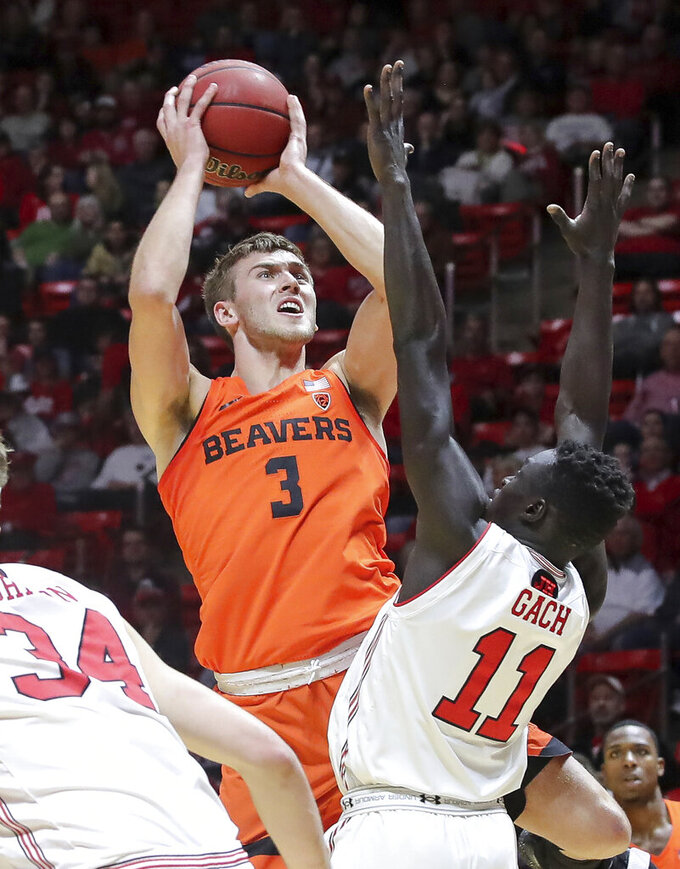 FILE - In this Feb. 2, 2019, file photo, Oregon State forward Tres Tinkle (3) shoots over Utah forward Both Gach (11) during the first half of an NCAA college basketball game, in Salt Lake City. Tinkle was named to the AP All-Pac-12 team, Tuesday, March 12, 2019. (AP Photo/Chris Nicoll, File)