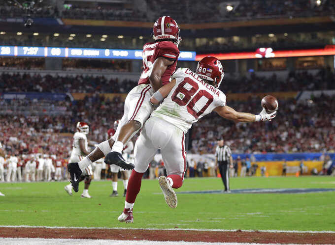 Alabama defensive back Xavier McKinney (15) defends Oklahoma tight end Grant Calcaterra (80) in the end zone, during the first half of the Orange Bowl NCAA college football game, Saturday, Dec. 29, 2018, in Miami Gardens, Fla. (AP Photo/Lynne Sladky)