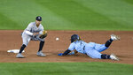 New York Yankees second baseman Thairo Estrada, left, waits for the throw as Toronto Blue Jays' Vladimir Guerrero Jr. safely steals second base during the sixth inning of a baseball game in Buffalo, N.Y., Monday, Sept. 7, 2020. (AP Photo/Adrian Kraus)