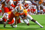 Tennessee running back Jabari Small (2) dives across the goal line for a touchdown as he's hit by Bowling Green linebacker Darren Anders (23) during the first half of an NCAA college football game Thursday, Sept. 2, 2021, in Knoxville, Tenn. (AP Photo/Wade Payne)