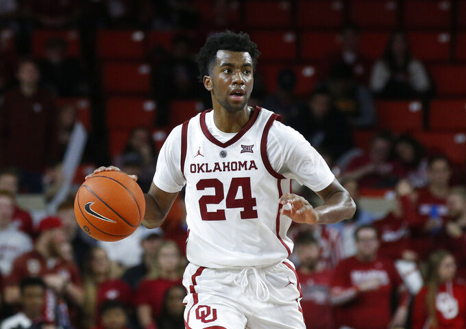 FILE - In this Feb. 9, 2019, file photo, Oklahoma guard Jamal Bieniemy (24) dribbles the ball during an NCAA college basketball game against Texas Tech in Norman, Okla. The Sooners believe they have building blocks in forwards Kristian Doolittle and Brady Manek and guard Jamal Bieniemy.  (AP Photo/Sue Ogrocki, File)
