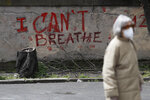 "A graffiti reading ""I Can't Breathe"" is seen on a wall in Rome, Wednesday, April 21, 2021. After three weeks of testimony, the trial of the former police officer charged with killing George Floyd ended swiftly: barely over a day of jury deliberations, then just minutes for the verdicts to be read — guilty, guilty and guilty — and Derek Chauvin was handcuffed and taken away to prison. The guilty verdict in the George Floyd trial was not just America's victory. It signaled hope for those seeking racial justice and fighting police brutality across the Atlantic. (AP Photo/Gregorio Borgia)"