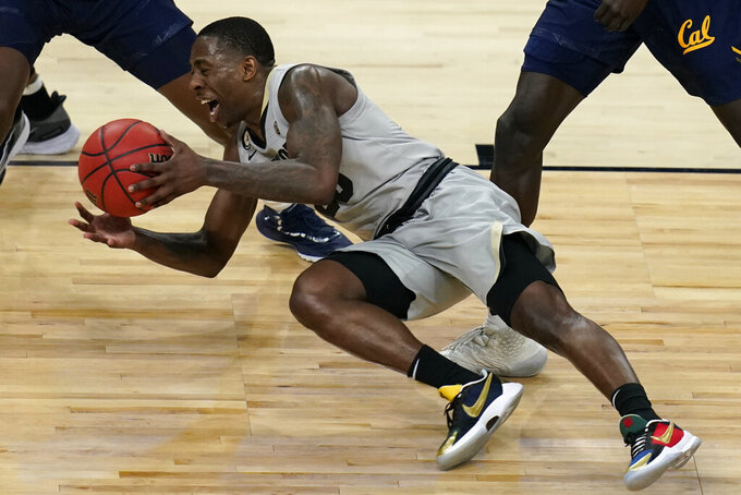 Colorado's McKinley Wright IV (25) falls while driving up the court against California during the second half of an NCAA college basketball game in the quarterfinal round of the Pac-12 men's tournament Thursday, March 11, 2021, in Las Vegas. (AP Photo/John Locher)