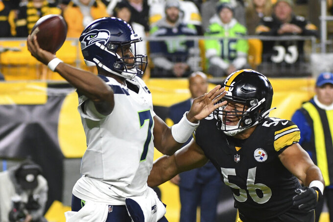 Pittsburgh Steelers outside linebacker Alex Highsmith (56) pressures Seattle Seahawks quarterback Geno Smith (7) in the first half of an NFL football game, Sunday, Oct. 17, 2021, in Pittsburgh. (AP Photo/Fred Vuich)