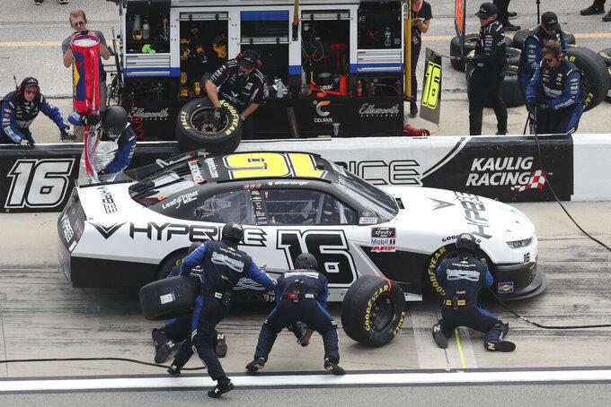 AJ Allmendinger (16) makes a pit stop during the early laps of a restart of the NASCAR Xfinity Series auto race at Daytona International Speedway, Saturday, Aug. 28, 2021, in Daytona Beach, Fla. (AP Photo/David Graham)