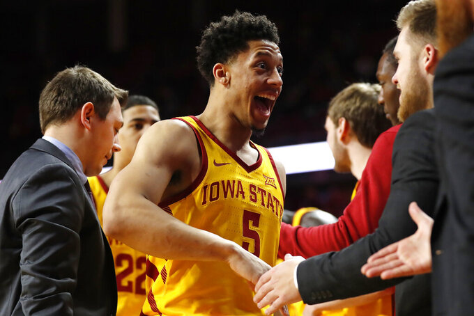 Iowa State guard Lindell Wigginton (5) celebrates with teammates during the second half of an NCAA college basketball game against West Virginia, Wednesday, Jan. 30, 2019, in Ames, Iowa. Wigginton scored 27 points as Iowa State won 93-68. (AP Photo/Charlie Neibergall)