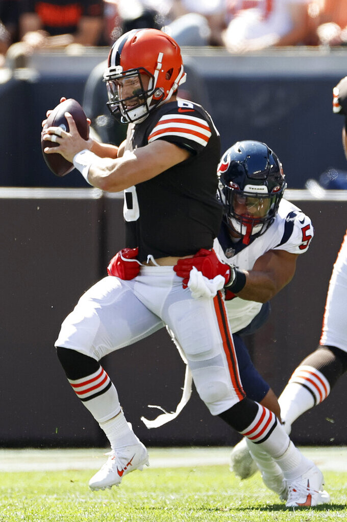 Houston Texans outside linebacker Kamu Grugier-Hill (51) sacks Cleveland Browns quarterback Baker Mayfield (6) during the first half of an NFL football game, Sunday, Sept. 19, 2021, in Cleveland. (AP Photo/Ron Schwane)