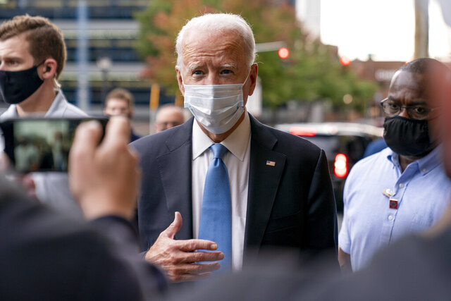 Democratic presidential candidate former Vice President Joe Biden stops to speak to members of the media as he walks out of the Queen Theater in Wilmington, Del., Thursday, Oct. 1, 2020, after pre-taping his speech for the Al Smith dinner. (AP Photo/Andrew Harnik)