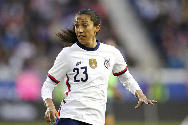 FILE - In this March 8, 2020, file photo, United States forward Christen Press looks for a pass during the second half of a SheBelieves Cup soccer match against Spain, in Harrison, N.J. Press says she wants to honor Kobe Bryant by playing for Manchester United wearing a No. 24 jersey. The American's usual No. 23 was already taken when she signed for a season with the English club earlier in September, 2020. (AP Photo/Steve Luciano, File)