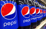 FILE - In this July 9, 2015, file photo, Pepsi bottles are on display for sale at a supermarket in Haverhill, Mass. PepsiCo Inc. reports earnings, Wednesday, Oct. 4, 2017. PepsiCo, which makes Frito Lay chips and Quaker cereals, is getting a boost as more U.S. consumers eat breakfast and snack at home. The Purchase, New York-based company said Tuesday, April 28, 2020, that its organic sales grew 7.9% in the first quarter. (AP Photo/Elise Amendola, File)
