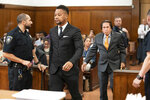 Cuba Gooding Jr. walks into a courtroom in New York, Thursday, Oct. 10, 2019. The actor is accused of placing his hand on a 29-year-old woman's breast and squeezing it without her consent in New York on June 9.  (Steven Hirsch/New York Post via AP, Pool)